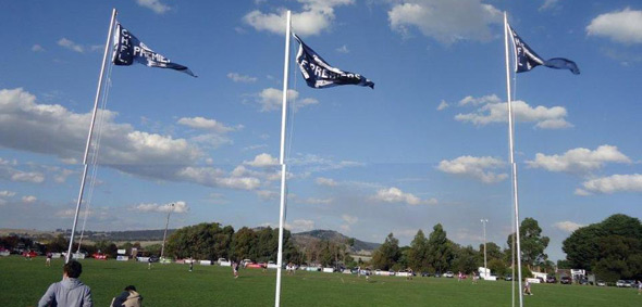 2011-raising-the-three-premiership-flags